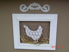 This is just so cute!! LOVE what she has done with the frame & chicken wire & hen inside...