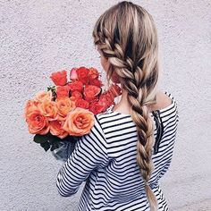 Here's a side dutch braid you can quickly make before heading out to a walk in the park or strolling down the neighborhood with friends.