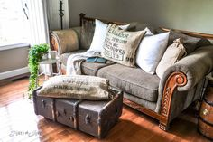 Rustic living room with a funky old trunk ottoman on wheels and burlap pillowcase. Trunk how to at : http://www.funkyjunkinterio...