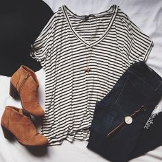 Simple outfit with the striped tee, dark washed jeans, light brown ankle boots, a black hat, and simplistic jewelry