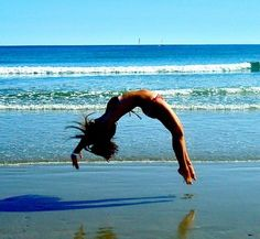 tumbling on the beach