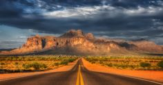 The Road to Superstition - Snapped in the middle of the road on August 14 of 2015, the day the temps hit 117 degrees!  It was also taken about 6:30 (give or take) and the Sun was setting almost directly behind my back.  The mountain glowed like this for about 2 minutes before getting dramatically darker.