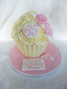 A pretty pink giant cupcake for a 65th birthday