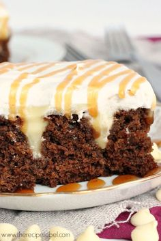 A moist, homemade gingerbread cake filled with homemade white chocolate pudding and topped with whipped cream and caramel sauce -- great for Christmas!