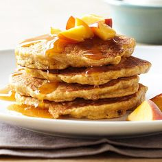 Fluffy Peach Pancakes and Chai Syrup make any brunch sweet. More Easter Brunch recipes: http://www.bhg.com/holidays/easter/recipes/an-easter-brunch-that-dazzles/?socsrc=bhgpin020113peachpancakes=2