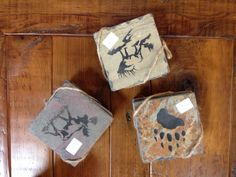 These unique slate coasters are etched with rustic pictures. Beautiful for the coffee table in your cabin or home! Come see how many designs we have!