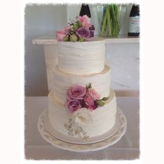 White rustic wedding cake with fresh flowers Made by @sweetsbysuzie Melbourne