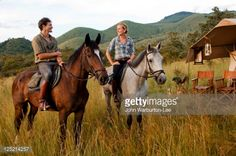 Stock Photo : Kenya, Chyulu Hills, Ol Donyo Wuas. Couple on a horse riding safari with Ride Africa in the Chyulu Hills (MR)