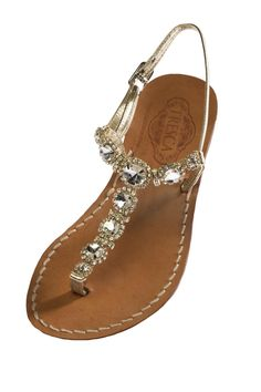 Lia is an Italian sandal that features clear crystals and gold accents adorning a gold, Italian leather adjustable strap and can easily be dressed up for a beach wedding, or worn as a statement piece when you're out to brunch or shopping. Lena comes in the 2 heel heights pictured and can be made to accommodate a wide width. Our soles are European sizes made in Italy. They are made from Italian leather with a wrapped, wooden heel. Please consult the size guide. If you're a half size, size up…
