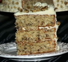 Learn how to make Black Walnut Cake Recipe frosted with a cream cheese frosting. This cake is baked in 3 eight inch round pans for about 30 minutes. Each layer is filled with the cream cheese frosting and I decorated with black walnut pieces.