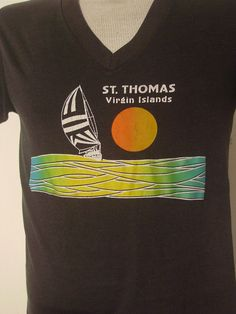 Vintage 1980s V neck t-shirt. Made of soft black poly/cotton. Reads: ST. THOMAS VIRGIN ISLANDS. Label reads: BLUE DIAMOND M. Actual measurements are: 37 around the chest, 36 around the waist, 17 shoulder seam to shoulder seam, 26.5 overall length. In very good condition.