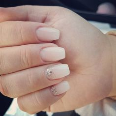 Rock an ombré shimmer over an opaque base close to your cuticles for wedding-ready nail art.