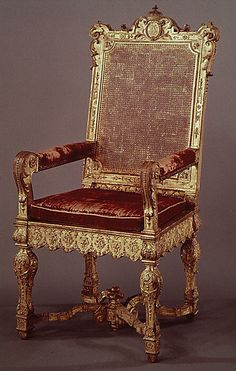 Armchair  Date:     ca. 1700–1710 Culture:     French Medium:     Carved and gilded walnut; caning, velvet