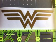 Wonder Woman Logo  Available in multiple sizes and colors. You have the choice to choose permanent or removable. The removable can be easily peeled