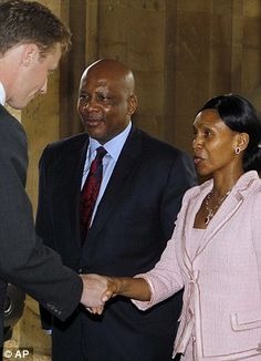 King Letsie III of Lesotho and Queen Mesenate Mohato Seeiso are greeted by a member of household staff
