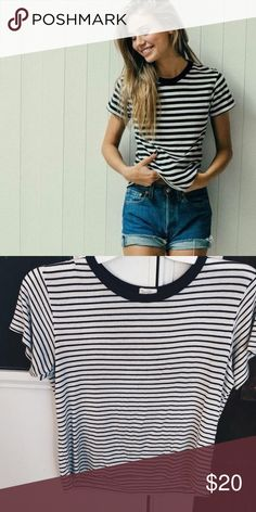 Brandy Melville Striped Nadine Brandy Melville ❤️  Black & White Striped Nadine Top   No Flaws !   Super Soft !   Very Comfy and Cute !   ✨TAGS: Brandy Melville, BM , American Apparel , AA , Urban Outfitters, UO , Topshop , LF , Unif , Tarte , Too Faced , Adidas , Nike ‼️MAKE OFFERS THROUGH BUTTON ONLY‼️❌NO TRADES PLEASE❌ Brandy Melville Tops