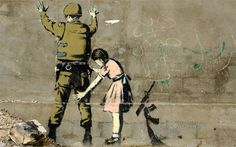 Banksy Stop and Search Girl and Soldier - Bethlehem, Israel Girl and a Soldier is one of the 2007 pieces that Banksy put up on a wall in Bethlehem. The innocent little girl is seen frisking an armed soldier in a stark reversal of roles. This along with other images on the wall were intended to promote the annual Santa's Ghetto exhibit. The piece is still visible although somewhat faded.