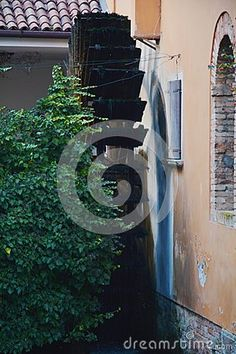 The famous and ancient mill in Treviso city, near the fish market and historical buildings, in Veneto, Italy. Images Of Faith, The Fish Market, Buildings, Italy, Stock Photos, Outdoor, Outdoors, Italia, Outdoor Games