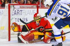 One-handed save -  Calgary Flames goalie Jonas Hiller makes a save as St. Louis Blues right wing Vladimir Tarasenko tries to score during a game on Oct. 13 in Calgary, Alberta, Canada. The Blues won 4-3. - © Sergei Belski/USA TODAY Sports