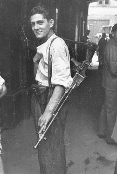 Warsaw uprising fighter 1944 Poland. He is carrying a Czech VZ26 LMG and a German P.38 pistol (from the holster)