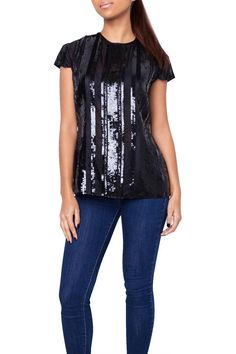 Black silk top with sequined panels and cap sleeves. Dress this top up with black pants blazer and stilettos. Dress it down with shorts and gladiator sandals.  Black Sequin Top by Zang Toi. Clothing - Tops - Short Sleeve Florida