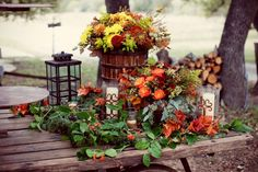 Vibrant fall table decoration from Old Glory Ranch   photography by http://www.christinacarrollphotography.com/