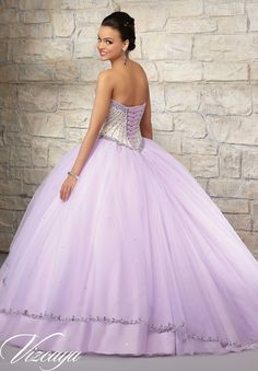 Matching Bolero Jacket included. Colors available: Champagne/Coral, Champagne/Light Purple and Champagne/Blush. Quinceanera Dresses by Designer Madeline Gardner.