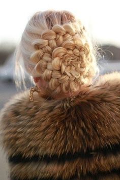 Sideways French braid into long braid & then coiled - looks crazy intricate but couldn't be more simple!!