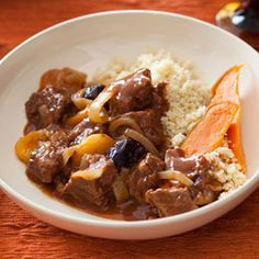 Slow-cooking brings out the aromas of this Eastern-inspired #lamb dish that's simmered with fall flavors and served with couscous. #dinner