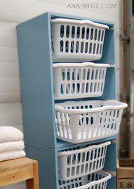 nice laundry idea..bookcase, baskets and drawer pulls