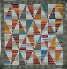 Long Diamonds Quilt Fabric Pack. Like the shape and the interesting use of stripy fabric.