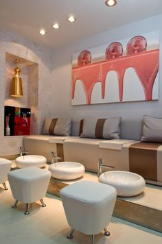 I love the wall art.....Interiorismo Blog: DISEÑO LOCAL: O.P.I Nail Bar