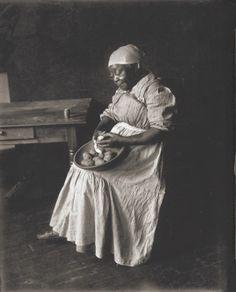 Unidentified African-American woman peeling potatoes. Missouri History Museum