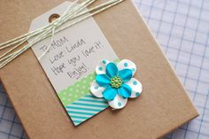 a simple and cool way to dress up a plain gift tag. @Linda Gardner