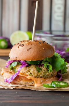 Spicy chickpea veggie burgers with jalapeño and zucchini, topped with a tasty honey-lime slaw and spicy Sriracha mayo. Freezer-friendly, GF, and vegetarian.