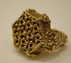 12-13th c. Iranian cast and engraved gold ring (Bezel 1/4 x 11/16 in., band dia. 7/8 in.) - Met Museum 1976.405