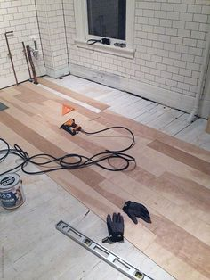A plywood plank floor. Much cheaper than hardwoods and they look great! Entry of home in foyer Plywood Plank Flooring, Diy Flooring, Flooring Ideas, Garage Flooring, Modern Flooring, Laminate Flooring, Plywood Kitchen, Kitchen Flooring, Kitchen Tile