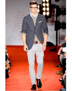 love the pairing of the chambray sportcoat w/ tan sweater and the light grey cargos. not crazy about the three-button sportcoat and no one would realistically wear a tie under their shirt...but i do appreciate the push on styling for the runway. :)