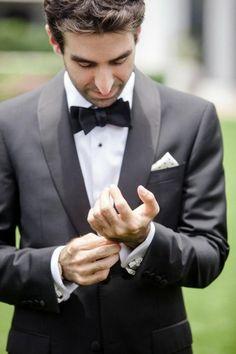 Dark gray suit with bow tie.