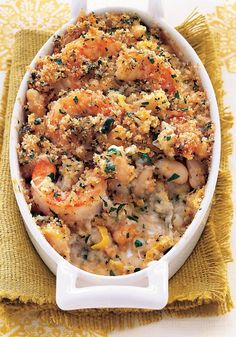 """Shrimp and White Bean """"Cassoulet"""" A traditional French casserole, cassoulet is usually made with sausage, duck fat and beans. This recipe has you use shrimp instead of meat, though, which takes away some of the heaviness and also has the bonus of cooki Seafood Dishes, Seafood Recipes, Cooking Recipes, Healthy Recipes, Dinner Recipes, Cajun Cooking, Cajun Recipes, Fish Recipes, Dinner Ideas"""