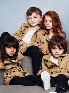 Heritage trench coats in miniature - boys and girls in the Burberry Childrenswear S/S14 campaign