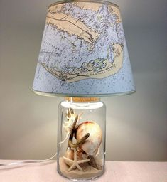 Cute Idea to Use Seashells Findings: Add them to a fillable transparent jar base for your map lampshade.   Find more DIY lamp inspiration, tutorials and supplies at www.ilikethatlamp.com  Sanibel Island Ocean Map Lamp. Fillable glass lamp! Via Florida Beachdweller FB: