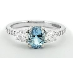 Add a touch of colour to your engagement this Christmas! This elegant design features a oval aquamarine centre stone, complemented on each side by a series of round brilliant cut diamonds. Thing 1, Three Stone Engagement Rings, Types Of Metal, Centre, Aqua, Diamonds, White Gold, Rose Gold, Touch