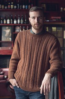"""The Bangor Pullover is the quintessential menswear pullover that any woman would be happy to """"borrow"""" from an unguarded closet. The simple cables, textured panels, and saddle shoulders are carefully crafted for an interesting project that results in a desirable garment."""