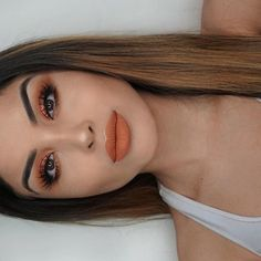 """@nikkimartinez_ completed her orange makeup look with our our """"Old Flame"""" Liquid Matte Lipstick #lotd #doseofcolors #doseofperfection"""