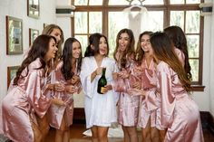 Glam Satin Bridesmaid Robes // A Glamorous White Orlando Wedding via TheELD.com