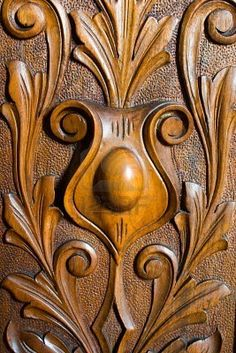 Detail of an ornate and antique wood carving
