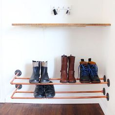 Make an industrial DIY floating copper shoe rack with items found in the plumbing aisle of the hardware store.