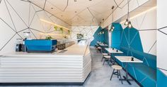 The interior of this cafe is covered in geometric panel shapes