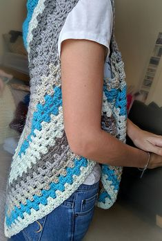 Inspired by the Caron Cake crazy that's sweeping the yarn world, this shawl/vest makes excellent use of this unique yarn's self striping quality. This free pattern, available on my blog, steps up the granny triangle shawl by adding arm-holes so it can also be worn as a vest!